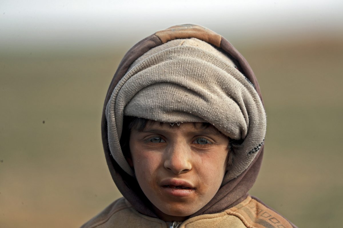 On 26 January 2019 in the Syrian Arab Republic, children and families are huddled together after being forced to flee their homes in nearby towns and villages, with their few belongings in Baghoz village in Hajin district in eastern rural Deir-ez-Zor before they embark on a long and ardous journey to safety at Al-Hol camp, almost 300km to the north.  On 26 January 2019 in the Syrian Arab Republic, after being forced to flee their homes in nearby towns and villages, children and families are huddled together with few belongings in Baghoz village in Hajin district in eastern rural Deir-ez-Zor, before they embark on a long and ardous journey to safety at Al-Hol camp, almost 300km to the north.  In the past three days alone, over 5,000 people have arrived at the camp from Hajin, bringing the number to around 23,000. Families arrive extremely exhausted after a three-day journey in harsh desert winter conditions with little food and shelter along the way.  UNICEF is on the ground at the camp and in screening centres, providing children and families with much-needed healthcare services, including basic treatment, malnutrition screening, and referral to hospitals when needed. UNICEF has also provided 500 heaters, 7,000 winter clothing kits and 10,000 thermal blankets to children and families and is providing ongoing tracking and family reunification support to unaccompanied and separated children at the camp.  In late January 2019 in the Syrian Arab Republic, escalating violence since December 2018 has forced thousands of people out of their homes in towns and villages in Hajin district in eastern rural Deir-ez-Zor. Families embarked on a long and arduous journey to safety at Al-Hol camp for internally displaced people, almost 300km to the north. In the past three days alone, over 5,000 people have arrived at the camp from Hajin, bringing the number to around 23,000. Lack of security has made humanitarian access to children en route to the camp's screening area all but