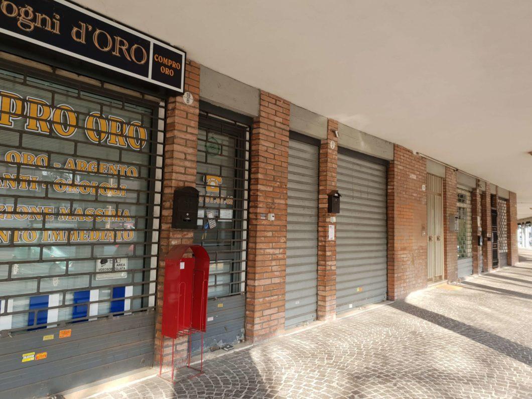 bologna negozi chiusi pandemia serrande