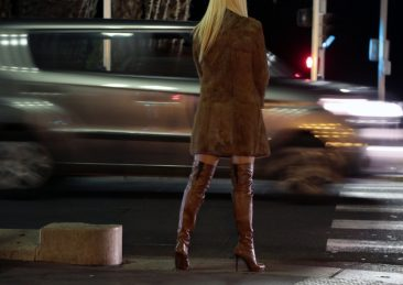 A prostitute from Eastern Europe waits for customers along the Promenade des Anglais in Nice
